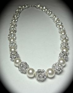 Blend of pearls and diamonds. Etsy listing at https://www.etsy.com/listing/161231656/pearl-necklace-chunky-bridal-jewelry