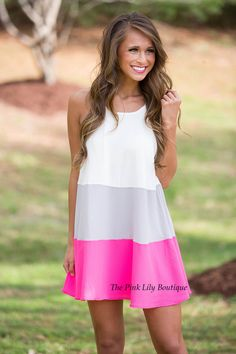 You are sure to be in the middle of the spotlight wherever you wear this little number! Chic and vibrant, it's the perfect dress for the new season! It features a colorblock style in pink, grey, and white for a bright summery pop of color, paired with spaghetti straps and breathable fabric that will keep you cool!