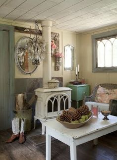 Romantic Prairie Style (pinned from A Beautiful Mess Antiques). I love so very many things about this but especially the wood stove. Cozy Cottage, Cottage Style, Best Wood Burning Stove, Mini Wood Stove, Deco Retro, Stove Fireplace, Fireplace Ideas, Wood Burner, Sweet Home