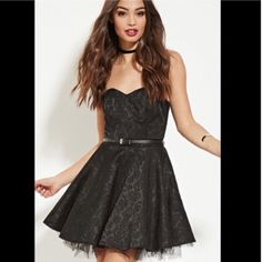"NWT Strapless lace black dress ➖SIZE: Small ➖CONDITION: NWT ➖STYLE: Black sleeveless dress with a belted middle and a tutu flare skirt design   LENGTH: from bust to hem: 25.75"" BUST: fits a 34B/C ish WAIST : 27.5""   This model is 5'7"" and is wearing a medium Forever 21 Dresses Strapless"