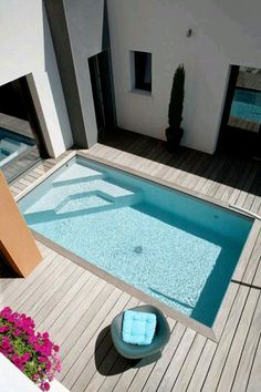 Swimming pool designs featuring new swimming pool ideas like glass wall swimming pools, infinity swimming pools, indoor pools and Mid Century Modern Pools. #modernpoolideas #modernpoolbeverlyhills