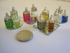 Items similar to Scale Dollhouse Miniature - 3 Assorted Perfume Bottles / Wine / Liquer Decanters on a Mirror Tray: Choice of Colors on Etsy Barbie Accessories, Dollhouse Accessories, Miniature Houses, Miniature Dolls, Diy Dollhouse, Dollhouse Miniatures, Minis, Bead Bottle, Perfume Display