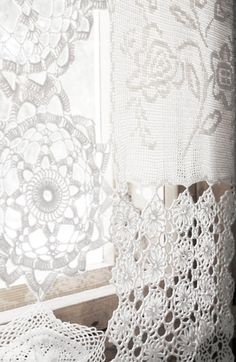 Lace Curtains for feminine details.  Lace curtains invite the sunlight in