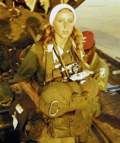 """""""In 1968 Catherine Leroy, one of the first female combat photographers of the Vietnam War era, surprised her North Vietnamese captors by photographing and interviewing them when they returned her cameras as they released her from detention. The photograph ended up on the cover of Life magazine."""""""