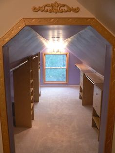 walk in closet in an attic/slanted wall room! (perfect for out of season clothes or consignment!)