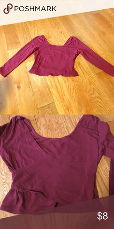 Maroon crop top Long-sleeved maroon crop top. Never been worn before. It has a crisscross back and a scoop neck front. Cotton fabric. Says medium but probably between a small and medium. Love Culture Tops Crop Tops