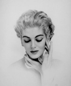 Bold eyebrows and dark lashes define this lovely 1950s face. #makeup #fashion #1950s