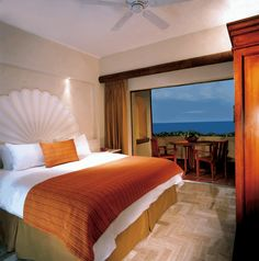 One-bedroom suites, with living and dining rooms and a balcony with breathtaking views of the gardens, pools and Pacific Ocean.  www.velasvallarta.com