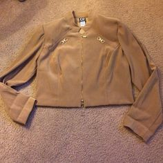 Beautiful tan jacket Beautiful tan jacket with gold details. The jacket has shoulder pads but they can easily be removed by cutting the thread that attaches them to the jacket Jackets & Coats