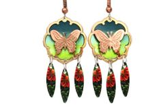 Butterfly jewelry created in exquisite designs, styles and colors on butterfly bracelets, butterfly earrings and necklaces in matching unique butterfly jewelry sets by Copper Reflections.