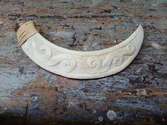 Ethnic boar tusk carved Artist : febby pamungkas