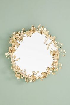Mirrors - Add a whimsical look to your decor with this Paradiso large round wall mirror with floral details along the frame made of iron in a gold finish.