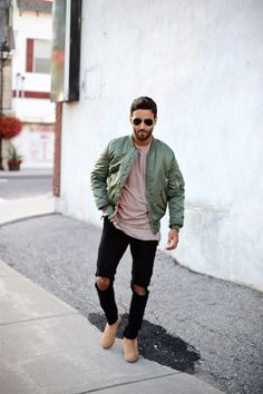 Green bomber jacket + taupe t-shirt + black distressed jeans + suede Chelsea boots