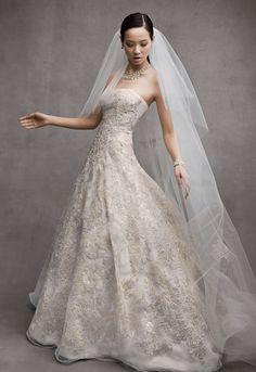 This opulent and ravishing mixed metallic wedding dress will stand out in every way! Oleg Cassini Style CWG592. #davidsbridal #olegcassini #weddingdress #mixedmetals