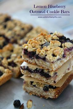 Lemon Blueberry Bars...a hint of lemon combined with the delicious taste of blueberries and a yummy oatmeal crust! Perfect for your sweet tooth craving...they're going to disappear fast!