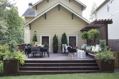 Bring an open, airy feeling to your deck with widened steps, integrated planters and accent lighting. With just 7 short steps, achieve this design in no time. Ground Level Deck, How To Level Ground, House Deck, House With Porch, Building A Porch, Outdoor Living, Outdoor Decor, Outdoor Spaces, Outdoor Ideas