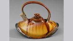 Teapot Idea ~ Fluid forms  Location: Conrow Porcelain Studio ~ Seattle ~ USA Artist: Ginny Conrow Materials: Porcelain and crystalline glaze. Copyright ©