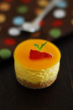 Learn how to make no bake eggless mango cheesecake. A good and easy summer dessert recipe with step by step pictures. Can be made with fresh or canned mango
