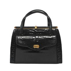 Elizabeth Arden 1960s Black Alligator Handbag | From a collection of rare vintage top handle bags at https://www.1stdibs.com/fashion/handbags-purses-bags/top-handle-bags/