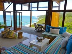 Living room opening onto sea deck. Cliff Top Houses, Wilderness, South Africa #seaviews #relax