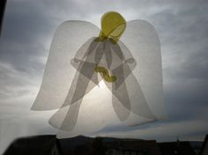 Translucent paper angel, window transparency