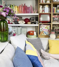 Parisian blogger and designer Éléonore Bridge turned her 377-square-foot apartment into a haven of inspired design. Color-coding adds playful interest to the bookshelf, while attractive boxes are used to stylishly organize the rest of Éléonore's belongings.