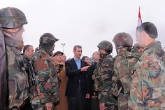 President Bashar al-Assad (c.) speaks to soldiers during a tour in the Baba Amr neighbourhood of Homs in this photo released by Syria's news agency SANA on Tuesday. Wonderland Events, Hot Dads, Fantasy House, Hot Hair Styles, Hot Outfits, Famous Women, Outdoor Life, Troops, Soldiers