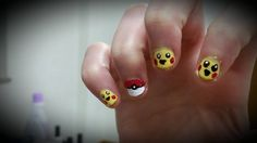 These Pokemon nails are actually really simple! A bobby pin allows you to draw the little lines and dots of the design.