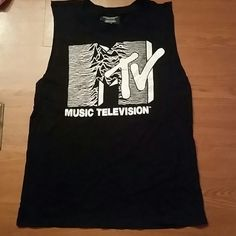 80's throw back Mtv cut out sleeveless tee Black original Mtv logo throwback sleeveless cutout armholes t-shirt.  Bought at forever 21 and never wore :(  Super cute! Forever 21 Tops Muscle Tees