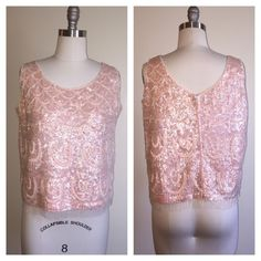 Vintage sequin beaded top ~ pastel pink Beautiful and in excellent condition. There is one tiny stain that is barely noticeable (last photo). Metal zipper in back with hook and eye closure at top. Size large. For specific measurements just ask  Vintage Tops Tank Tops