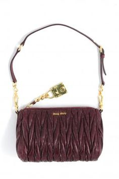 miu miu shopping bag in burgundy red ribes shiny matelasseé leather. The bag  is used 6aee15d910aff