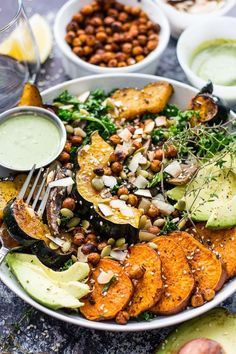 This Sweet Potato, Squash and Kale Buddha Bowl with cilantro-tahini dressing & crispy chili-lime chickpeas!