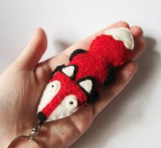 MADE TO ORDER -- A lovely red fox made of felt. He is very smart for a keychain! The keyring has been made using a ruby red felt with beautiful dark veins, perfect to express the fantastic fur of the fox. The felt is also very resistant and the key chain has been stuffed