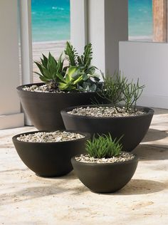 Delano Round Planter from Crescent offered in four sizes and two colors