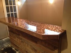 Pallet face with penny and epoxy bar top
