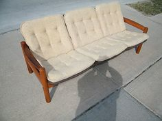 Mid Century Modern Domino Brand Danish Modern Sofa Mobler Denmark Teak Wood | eBay. $749, but you have to pick it up in Omaha. A nice, small-scale piece that needs a little refinishing.