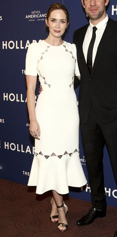 Emily Blunt joined hubby John Krasinski at the New York screening of The Hollars in a stunning David Koma LWD with a flouncy hem and neat Plexi and laser-cut embroidery along the bodice and hem—a finishing touch she matched with her EFFY jewelry and metallic Tory Burch sandals.