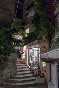 Positano,Italy (up these stairs - I think I could find it again, you sit on the curb, & a man holds your foot and makes you a custom sandal.  For 20 dollars!   What a wonderful treat!)
