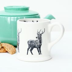 Created in the heart of the potteries, this sturdy half pint tankard features a hand drawn stag illustration on the outside and a row of silhouetted stags designs along the inside. Made entirely within the UK, this mug will make the perfect addition to the home of anyone who is passionate about British wildlife and drinking tea. made from: Natural coloured high quality British Earthenware dimensions: Capacity - 1/2 pint H9.5 xW11.5 cm (including handle)  Dishwasher safe Continue reading →