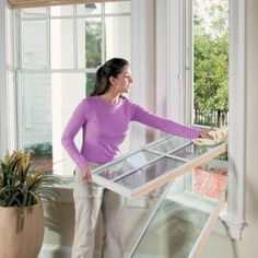 woman cleaning tilted-in window