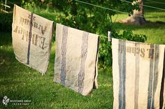 clothesline with beautiful grain sacks - many dresses, aprons, etc. were made using feed sacks. Primitive Laundry Rooms, What A Nice Day, Vintage Laundry, Miss Mustard Seeds, Feed Sacks, Grain Sack, Linens And Lace, Hanging Out, Burlap