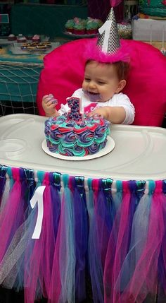 Under the Sea themed little girls birthday party. First Birthday party. Teal, pink, purple and iridescent tulle highchair skirt