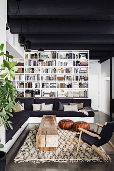 9 Must-Haves for a California Eclectic Home// layered bookshelves, Moroccan rug, leather pouf