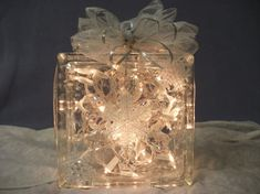 Christmas Decorative Lighted Glass Block With Clear Lights Decorated In Snowflakes With Handmade Silver Trimmed Bow with White Snowflakes