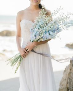 Love the color blue? California Floral & Design gathered long stems of delphinium into a modern bouquet for this beach bride. Cascading Wedding Bouquets, Bride Bouquets, Flower Bouquet Wedding, Bouquet Bleu, Bouquet Photography, Bridal Looks, Blue Wedding, Bunt, Marie