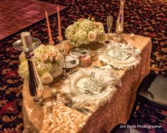 Half Round table with peach decor linens from Luxe Petals.  Ambient light wedding photography by Jim Rode