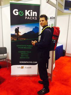 A colleague demonstrates the latest Go Kin Packs prototype at the OCE Discovery show in Toronto, May 2014 Discovery, Behind The Scenes, Packing, Toronto, Bag Packaging