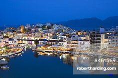 View over harbour and restaurants at dusk, Ayios Nikolaos, Lasithi region, Crete, Greek Islands, Greece, Europe