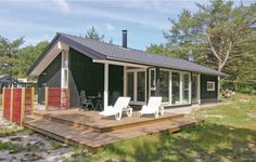 Holiday Home Aakirkeby with a Fireplace 01 Aakirkeby Holiday Home Aakirkeby with a Fireplace 01 is a holiday home located in Vester S?marken in the Bornholm Region and is 20 km from R?nne. Guests benefit from free WiFi and private parking available on site.
