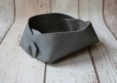 A personal favourite from my Etsy shop https://www.etsy.com/uk/listing/399239583/grey-leather-valet-tray-rustic-leather